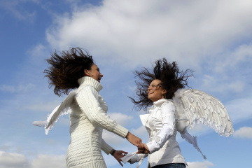 Cirque du Soleil fans, wearing angel wings, dance during a promotional event in Moscow